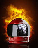 Red moto helmet in Fire — Stok fotoğraf