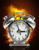 Old-fashioned alarm clockin Fire — Stockfoto