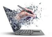 Hand with the pencil exit by a monitor of laptop screen — Stock Photo