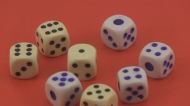 Dice that are used in games and for gambling rotating on a red background. — Stock Video