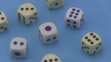 Dice on a blue background. — Stock Video