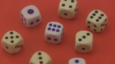 Dice on a red background. — Stock Video