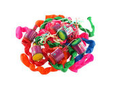 Close up of balloons and party poppers — Stock Photo