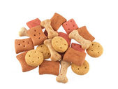 Assorted shaped dog biscuits on a white background. — Stock Photo