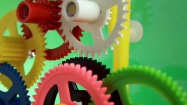 Working multicolor plastic toy cog of clockwork — Stock video