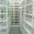 Empty warehouse, storage  racks - Foto Stock