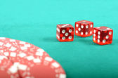 Poker gambling chips on a green playing table — ストック写真