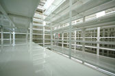 Empty warehouse, storage racks — Stock Photo