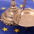 Stock Photo: Scales of justice and Flag of Europeunion flag
