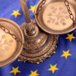 Stock Photo: Scales of justice and Flag of Europeunion