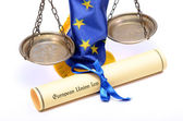 Scales of Justice, European union flag and European union law — Stock Photo