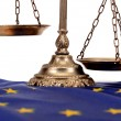 Stock Photo: Scales of justice on EuropeUnion flag