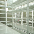 Empty warehouse, storage  racks — Stockfoto