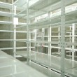 Empty warehouse, storage  racks - Stock Photo