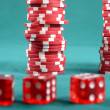 Stock Photo: Red poker gambling chips on green playing table
