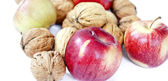 Composition from apples and nuts — Stock Photo