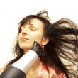 The woman dries hair the hair dryer — Stock Photo #13616829
