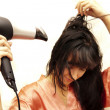The woman dries hair the hair dryer — Stock Photo #13616841