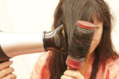 The woman doing a coiffure — Stock Photo