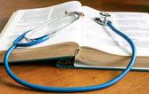 Stethoscope, book, on a desktop — Stock Photo