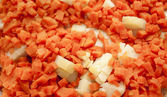 Cutting by cubes carrots and potatoes — Stock Photo