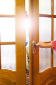 Opening of wooden doors — Stock Photo