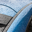Splashes and water drops on of the car — Stock Photo #29796281