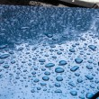 Texture - water drops on a blue body of the car — Stock Photo