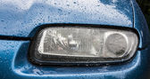 Car headlights after a rain — Stock Photo