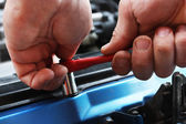Car repairs by the mechanic — Stock Photo