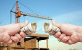 Hundred dollar notes of the USA in a hands against a constructio — Stock Photo