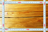 Frame a measuring ruler against texture of a tree — Stock Photo
