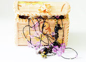 Various women's beautiful jewelry in a wicker box  — Stok fotoğraf