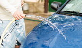 The process of washing cars with a hose — Stock Photo