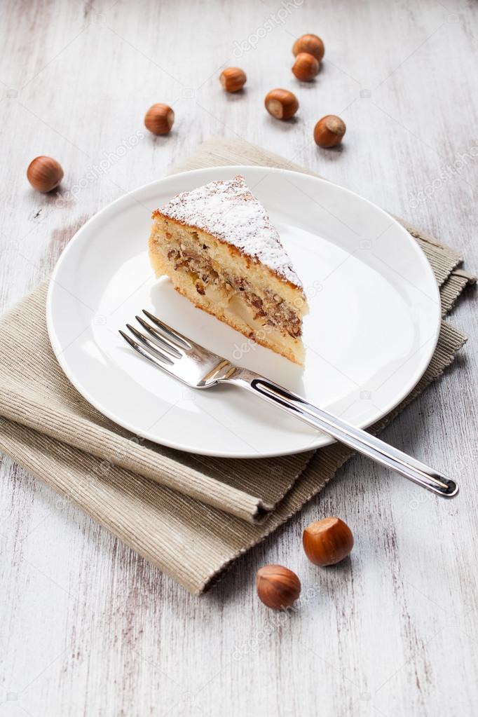 Slice of cake to the nuts on dish — Stock Photo #13396737