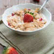 Постер, плакат: Breakfast cereals with milk and strawberries