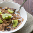 Breakfast cereals with milk and kiwi — Stock Photo