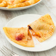 Crepes with fruit — Stock Photo