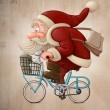 Santa Claus rides the bicycle — Stock Photo