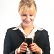 Smiling business woman with a mobile - Stock Photo
