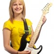 Young smiling girl with an electric guitar — Stock Photo