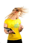 Young attractive girl dancing with a tablet — Stock Photo