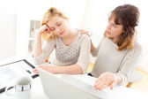 Girl sleeping instead of working with her friend — Stock Photo