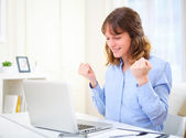 Portrait of a young happy business woman at work - success conce — Stockfoto
