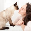 Woman  having good times at home with cat  — Stock Photo #44535563
