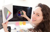 Woman photographer calibrate her screen — Stock Photo