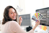 Young woman photographer choosing color — Stock Photo