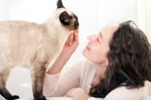 Woman  having good times at home with cat  — Stock Photo