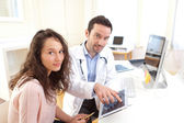Doctor using tablet to inform patient  — Stock Photo