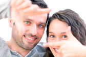 Young couple watching life through screen — Stock Photo